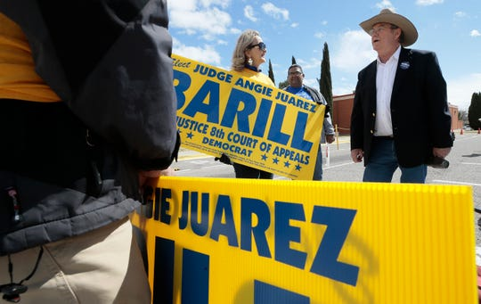 Patrick Bramblett, candidate for 383rd District Court, talks with Armida and Victor Calzada, left, who were outside Cielo Vista Elementary School on Tuesday, March 3, 2020, campaigning for Judge Angie Juarez Barill.