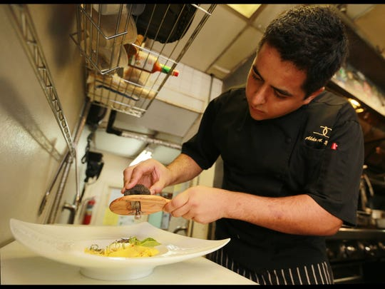 Chef Aldo Mora applied the finishing touches on his truffle parpadil.