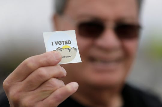 "East El Paso resident Raul Silva shows his ""I Voted"" sticker after voting Tuesday at Cielo Vista Elementary School."