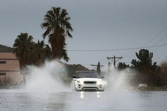 Drivers make their way through large puddles of water on Resler Drive on the West Side of El Paso on Tuesday, March 3. The National Weather Service's prediction of a 70% chance of rain Tuesday was correct.