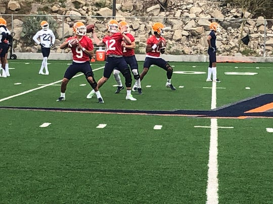 From left, Calvin Brownholtz, Gavin Hardison, Isaiah Bravo and TJ Goodwin throw passes during Tuesday's UTEP football practice at Glory Field