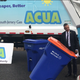 Millville Mayor Michael Santiago poses Tuesday with the mascot for the Atlantic County Utilities Authority. The city and ACUA were displaying a new type of large trash container and custom truck that go into service April 1, 2020.