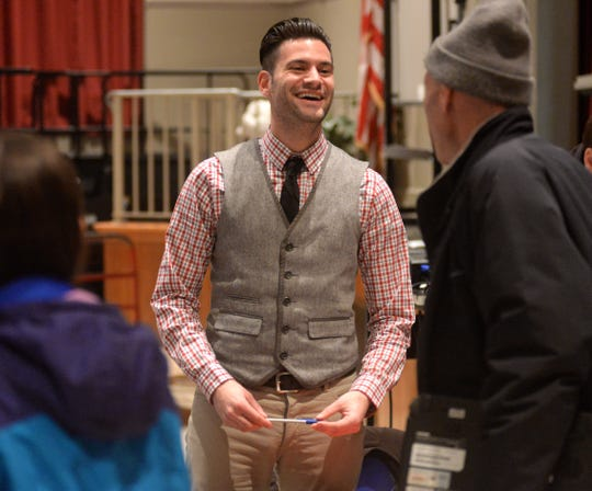 Steven Calakos, (center), directing the Vineland Public School District's spring play after taking over from the late Mark Melamed. He is  talking to parents and students auditioning during tryouts at Veterans Memorial School Monday night January 13, 2014.