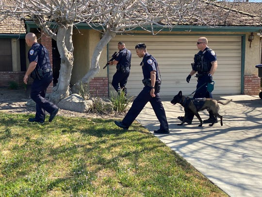 Visalia police are searching for a man with a gun near Johnson Street and Vassar Avenue.