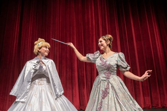 Tyler Fleeman as Cinderella, left, and Kristyne Mauricio as the Fairy Godmother in Enchanted Playhouse's production of Cinderella on Monday, March, 2, 2020.