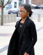 Sabrina Charles-Pierre, a board member with the East Ramapo Central School District, leaves the federal courthouse in White Plains, March 3, 2020.