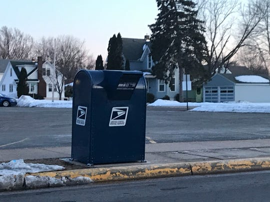 A blue U.S. Postal Service mailbox on Fourth Street South by the Wisconsin Rapids post office