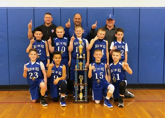The Zanesville fourth grade team won the state championship for their division at the 2020 Ohio Youth Basketball Division II State Championship in Columbus. Pictured are (Front row, Left to Right): Braelyn McGovern, Karter Burrell, Titan Grandstaff, Leevi Wade. Middle row (L to R): Brody Boothe, Caleb Hollins, Beau Young, Jacobie Balo, Connor Johnson. Back row (L to R): Head Coach Derek Boothe, Coach Mike Young, Coach Chad Grandstaff.