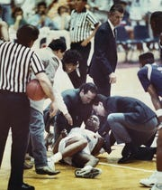 Hank Gathers is attended to after collapsing during Loyola Marymount's conference tournament game against Portland.