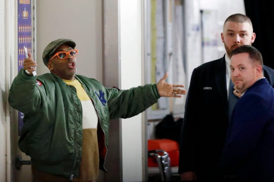 Spike Lee gestures in a hallway at Madison Square Garden while arguing with security officers before the Knicks-Rockets game March 2.