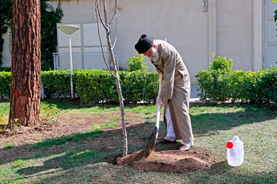 Iran's Supreme Leader Ayatollah Ali Khamenei participates in a tree planting ceremony in Tehran, on March 3, 2020.