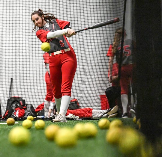 Palmetto softball senior Kenley Powell hits a ball during practice Wednesday.