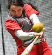 Palmetto softball senior Claire Ellison hits a ball during practice Wednesday.