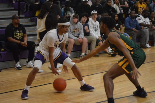 ASH senior Dez McQuain (11) tries to get past a Captain Shreve defender Tuesday.