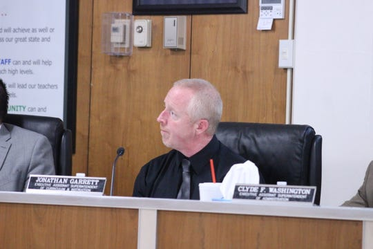 Jonathan Garrett, the district's interim executive assistant superintendent for curriculum and instruction, briefed board members on proposals for new science and math curriculums. The board unanimously approved both motions.