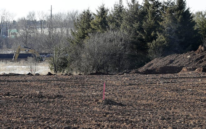 The town of Neenah is building a seven-acre stormwater pond south and east of Ogden Development on North Street. The excavated soil is being spread on land immediately west of Oak Hill Cemetery.