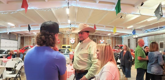 Sheriff Ricky Bishop talks with supporters at a watch party at Countryside Classic Venue between Abilene and Tuscola.