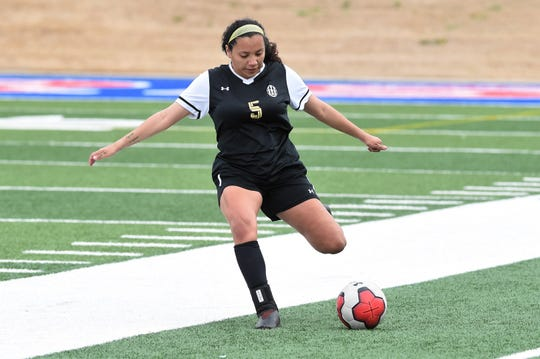 Abilene High's Aliyah Monroe (5) takes a free kick against Euless Trinity in a District 3-6A game March 3 at Shotwell Stadium.