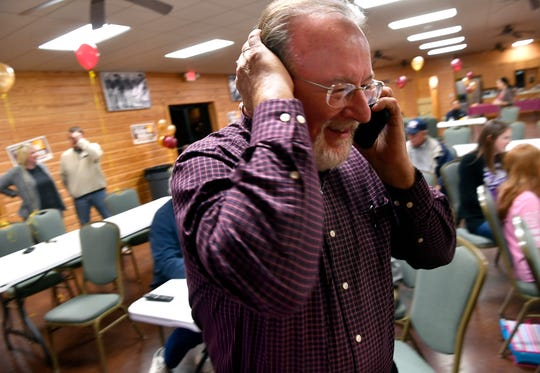 Randy Williams takes a phone call while watching Tuesday's election returns at the Taylor County Expo Center. Williams effectively won another term as county commissioner in Tuesday's primary race.