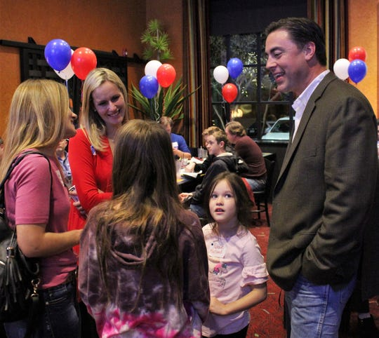 Jeff Propst, who won the most votes for 104th District Court judge Tuesday but faces Kevin Willhelm in a runoff, talks with Tiffany Blizzard, left, and her children Claire (back turned) and Natalie, center, at his watch party at Miguel's Mex Tex Cafe. Joining the conversation is April Propst, the candidate's wife, second from left.