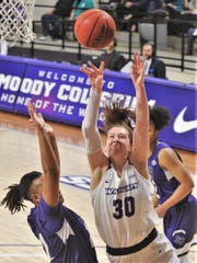 ACU's Anna McLeod (30) drives to the basket against the Stephen F. Austin defense. The Wildcats beat SFA 88-62 in the Southland Conference game Tuesday, March 3, 2020, at Moody Coliseum.