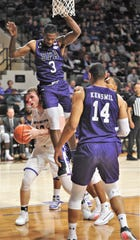 ACU's Clay Gayman, left, is fouled by Stephen F. Austin's Cameron Johnson (3) in the first half