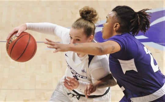 ACU's Madi Miller, left, tries to get around Stephen F. Austin's Zya Nugent in the first half.