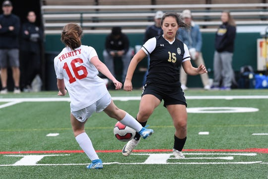 Abilene High's Justine Martinez (15) goes for the ball against Euless Trinity's Emma Andersen (16) in a District  3-6A game March 3 at Shotwell Stadium.
