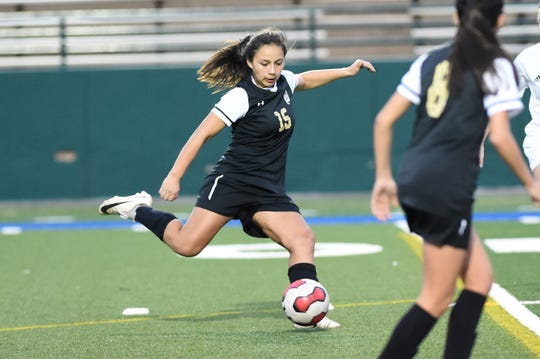 Abilene High's Justine Martinez (15) takes a shot during Tuesdays game against Euless Trinity at Shotwell Stadium. Martinez scored the Lady Eagles lone goal in the 6-1 loss.