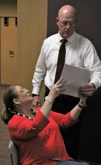 Terri Birchum points out results to Taylor County Precinct 3 Commissioner and husband Brad in the lobby of the Taylor County Plaza on Tuesday night. Birchum led early voting to finish against challenger Jeff Dressen to win a second term.