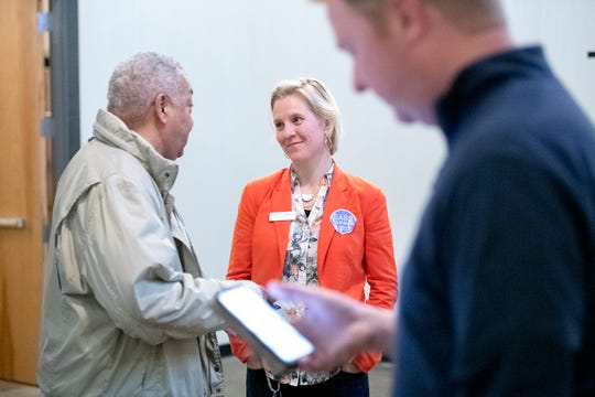 Asheville City Council candidate Sage Turner talks with Buncombe County Commissioner Al Whitesides during a Democratic Party primary election results event at Highland Brewing Company on March 3, 2020.