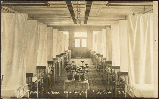 Postcard showing a photo of a ward at the Camp Custer hospital, c. 1918. Between September 16 to November 15, Camp Custer reported 7,686 cases of influenza, 2,365 cases of pneumonia, and 672 deaths.