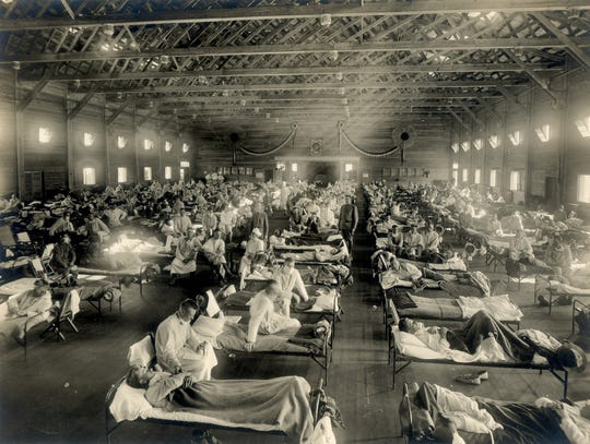 Beds with patients in an emergency hospital in Camp Funston, Kansas, in the midst of the 1918 influenza epidemic.