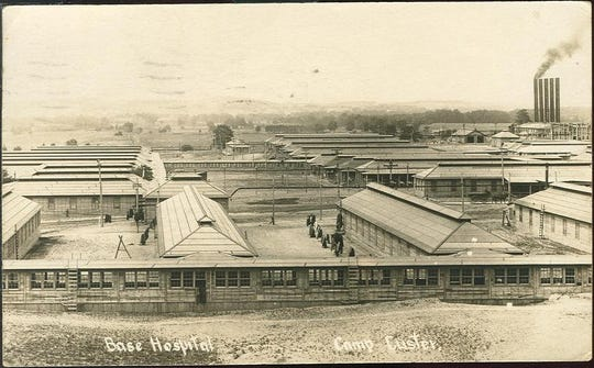 Postcard showing an aerial view of the Base Hospital at Camp Custer. These photos were taken from cameras sent up on kites to photograph the base.