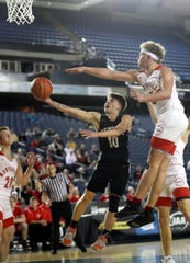 Central Kitsap's Colby White puts up a shot against Marysville-Pilchuck's Cameron Stordahl during Wednesday's Class 3A state tournament game at the Tacoma Dome. Central Kitsap fell 63-48.
