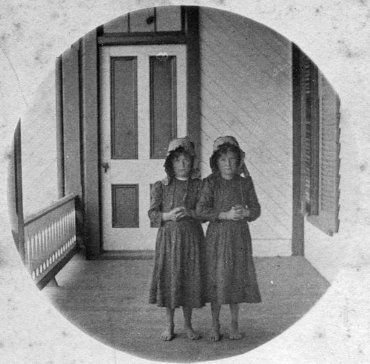 This photo, taken by Gertrude Sprague, shows two young visitors on the porch of the Black Mountain Hotel at the turn of the 19th century.