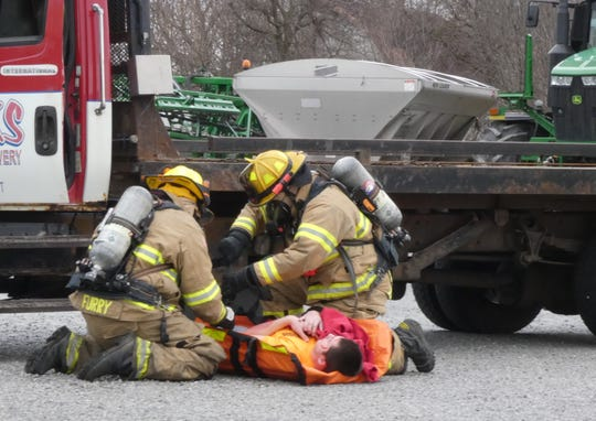 First responders aid a crash victim during the annual LEPC training exercise Wednesday morning at Sunrise Cooperative in Crestline.