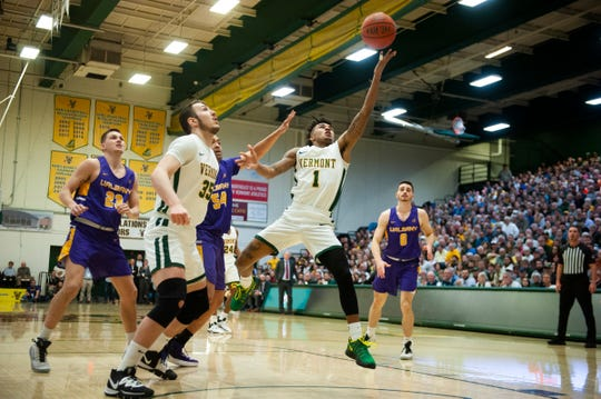 Vermont's Aaron Deloney (1) leaps for a layup during the men's basketball game between the Albany Great Danes and the Vermont Catamounts at Patrick Gym on Tuesday night March 3, 2020 in Burlington, Vermont.