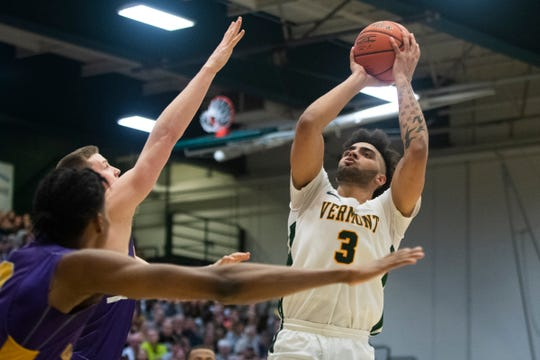Vermont's Anthony Lamb (3) shoots the ball during the men's basketball game between the Albany Great Danes and the Vermont Catamounts at Patrick Gym on Tuesday night March 3, 2020 in Burlington, Vermont.