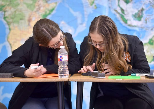 Alice High School seniors Genevieve Toureilles and Madison Timmons prepare for the Academic Decathlon state competition, set for March 6 and 7. The Alice team is ranked No. 1 in the state in the medium schools category.
