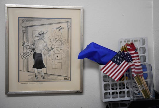 A political cartoon sits in the League of Women voters office, Tuesday, Feb. 4, 2020, in Austin. Women's centennial for being able to vote is celebrated this year.