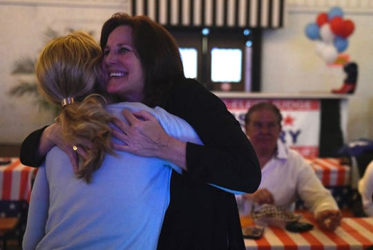 Missy Medary hugs a supporter at Bar Under The Sun tavern in downtown Corpus Christi as Super Tuesday election results are released on March 3, 2020. Medary is the incumbent in the 347th District judge's race.