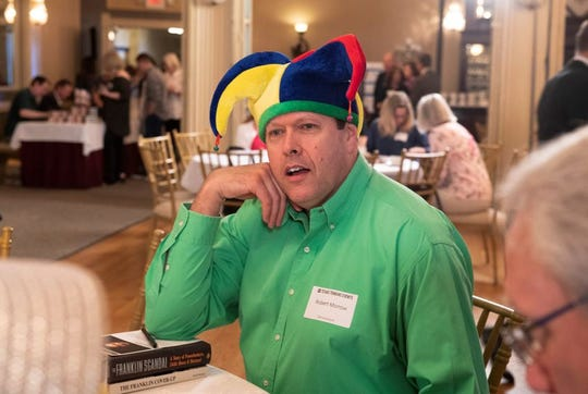 Robert Morrow has a history of sexist and racist rhetoric and is known for wearing a jester's hat.
