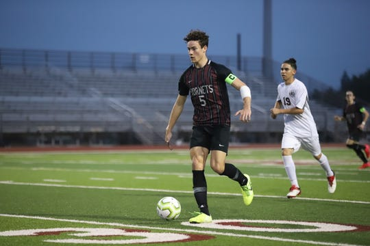 Flour Bluff junior captain Aidan Featherby dribbles the ball against Tuloso-Midway in a District 29-5A boys soccer match on Tuesday, March 3, 2020. The Hornets won 12-1.