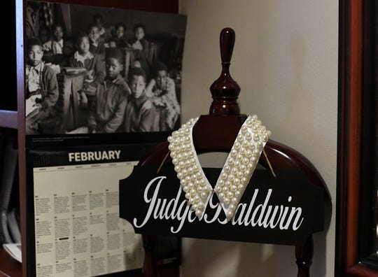 Harris County Judge Shannon Baldwin has a pearl collar that sits in her office, Tuesday, Feb. 18, 2020, in Houston. Baldwin is one of the 19 black judges elected during the 2018 election in Harris County.