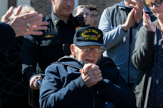 World War II veteran Sgt. Anthony 'Tony' Baldorossi thanks community members as he's honored in Burlington City Wednesday, March 4, 2020.