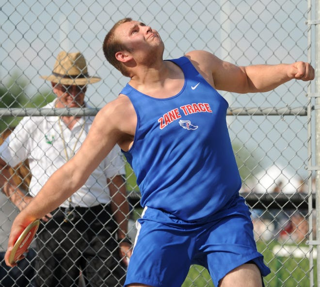 Zane Trace grad Walt Petzel throws discus at the 2014 Scioto Valley Conference Championships. Petzel won a Mid-American Conference Championship in shot put at the 2020 MAC Indoor Championships for Kent State University over the weekend.