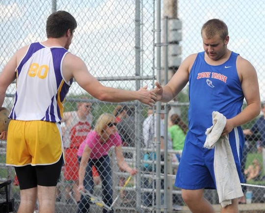 Unioto's Trevor Detillion, left, congratulates Zane Trace's Walt Petzel on his throw in the 2014 championship flight of the Scioto Valley Conference track meet at Myrl Shoemaker Athletic Complex.
