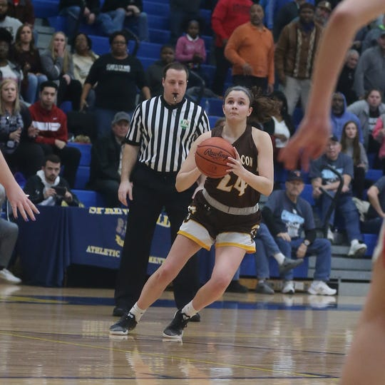 Roger Bacon guard Kelly Brenner shoots the 3-point shot that put the Spartans ahead during their 53-51 win over Jonathan Alder, Tuesday, March, 3, 2020.