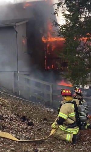 Firefighters work to put out a blaze on Tahoe Terrace Wednesday.